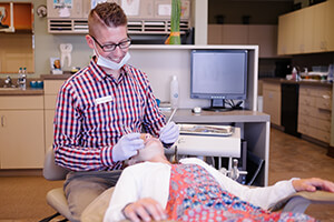 Doctor with patient - Pediatric Dentist in Noblesville, IN